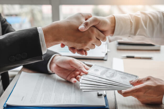 Hands shaking a deal