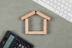 Wooden house model and calculator